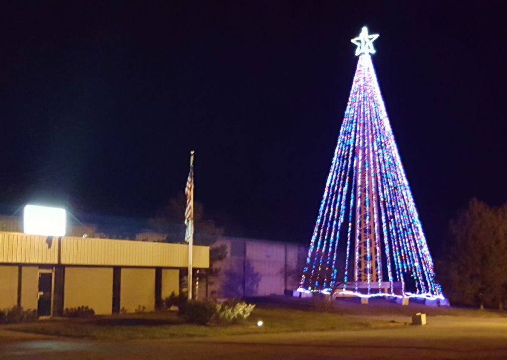 Custom Service Crane's custom-made Christmas tree using a tower crane, 15K lights, and a 10 foot start.