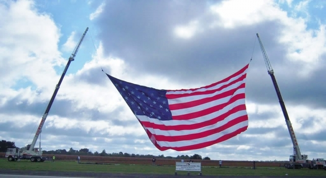 Two of CSC's crane's hoisting the world's largest flying USA flag