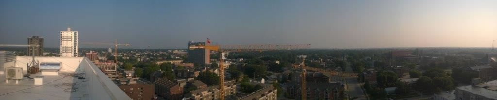 Panoramic view with three tower cranes in Champaign-Urbana