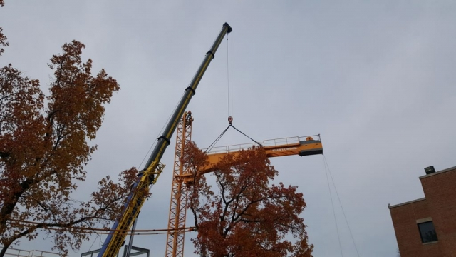 275 crane assembling tower crane in Clayton, MO