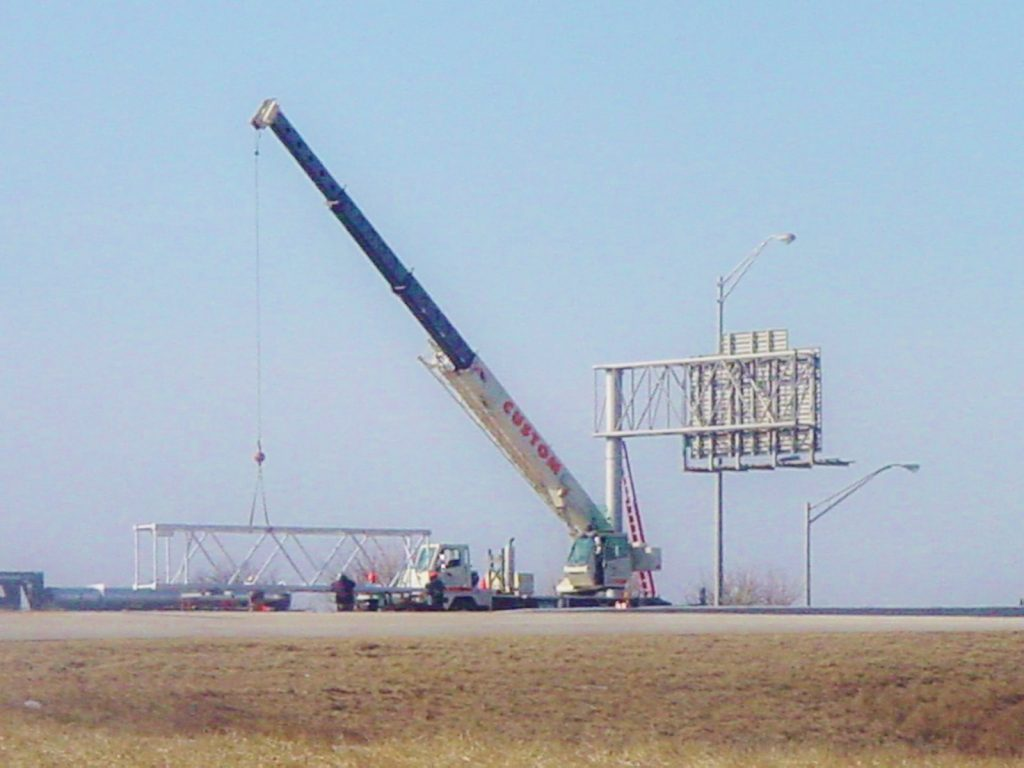 30 ton crane is assisting with a new highway sign.