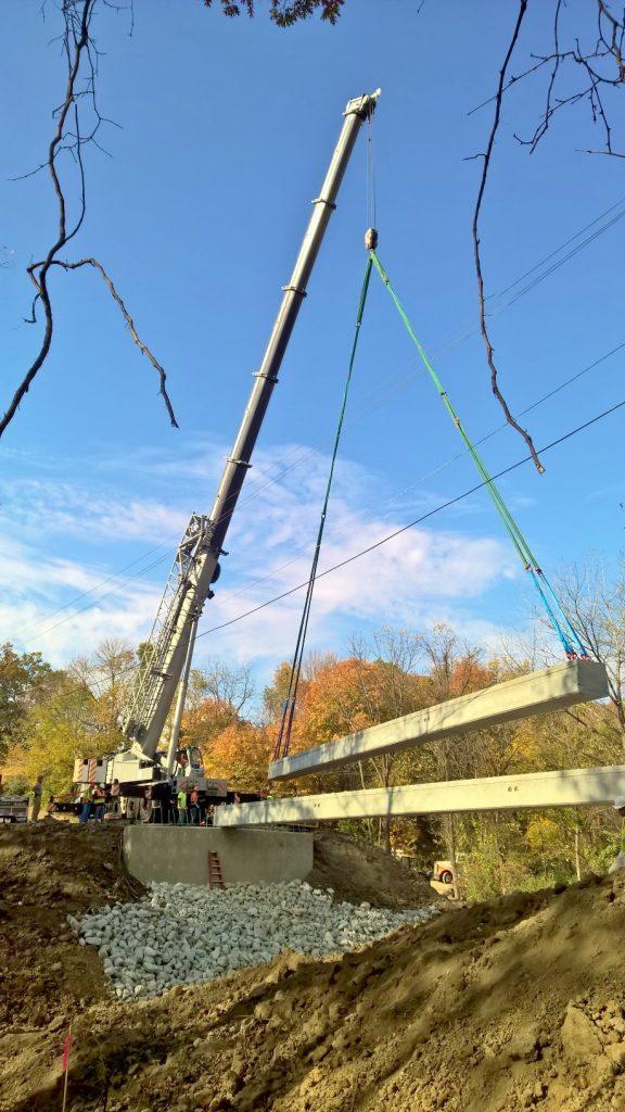 Bridge beams being set by a 275 ton crane in Oakwood, IL.