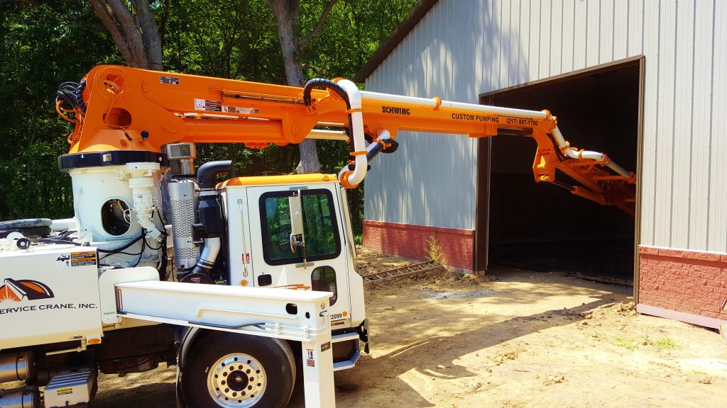 Custom Concrete Pumping helps build the concrete walls in a residential bunker with the 31 meter truck.