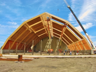 50 ton hydraulic crane assists with pole barn construction
