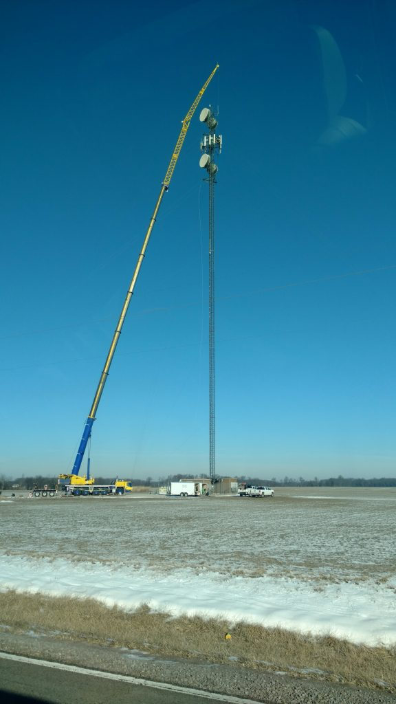 A 275 ton hydraulic crane works on a cell tower in DuBois, IL.