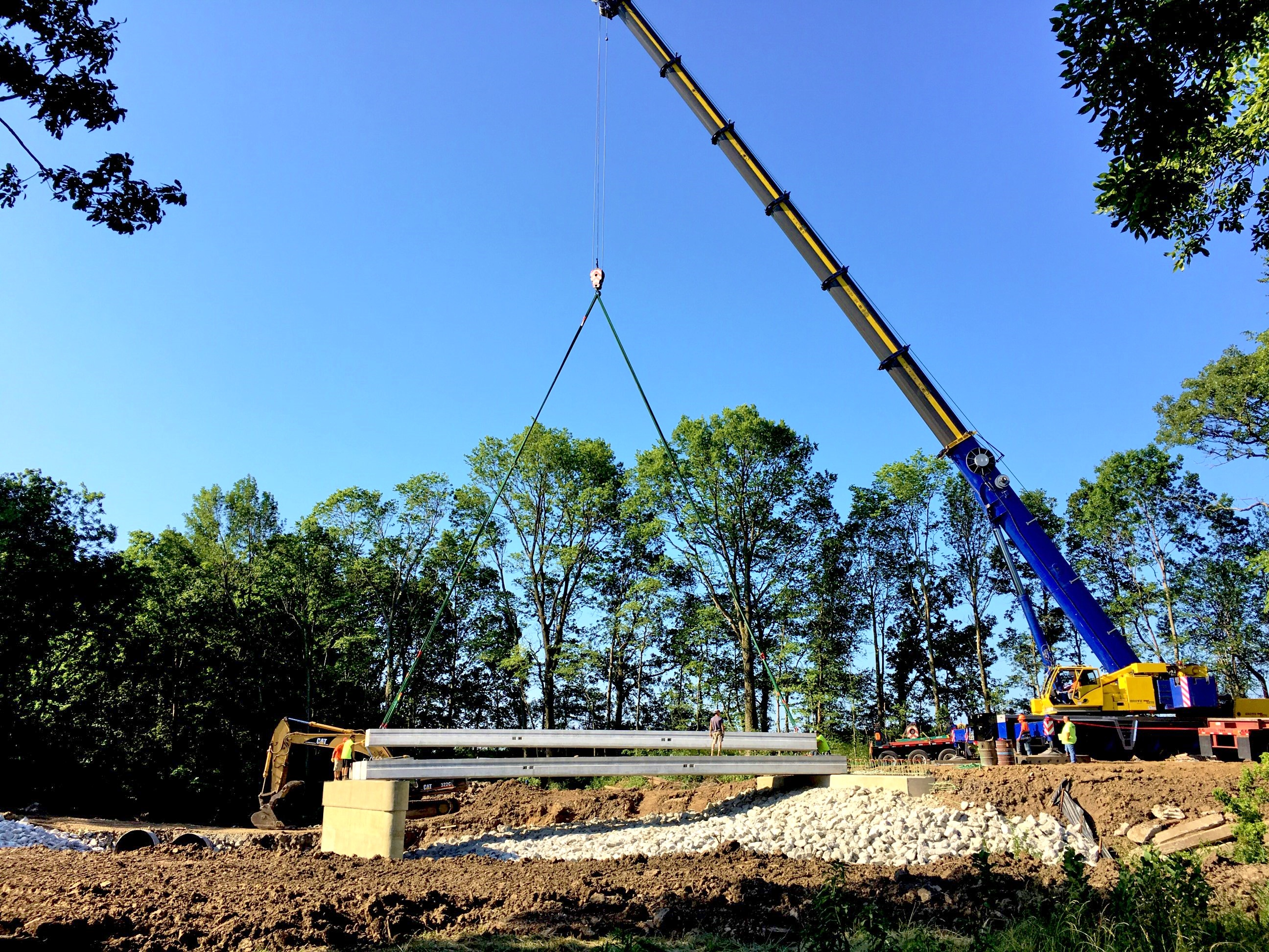 A 275 ton crane sets bridge beams.