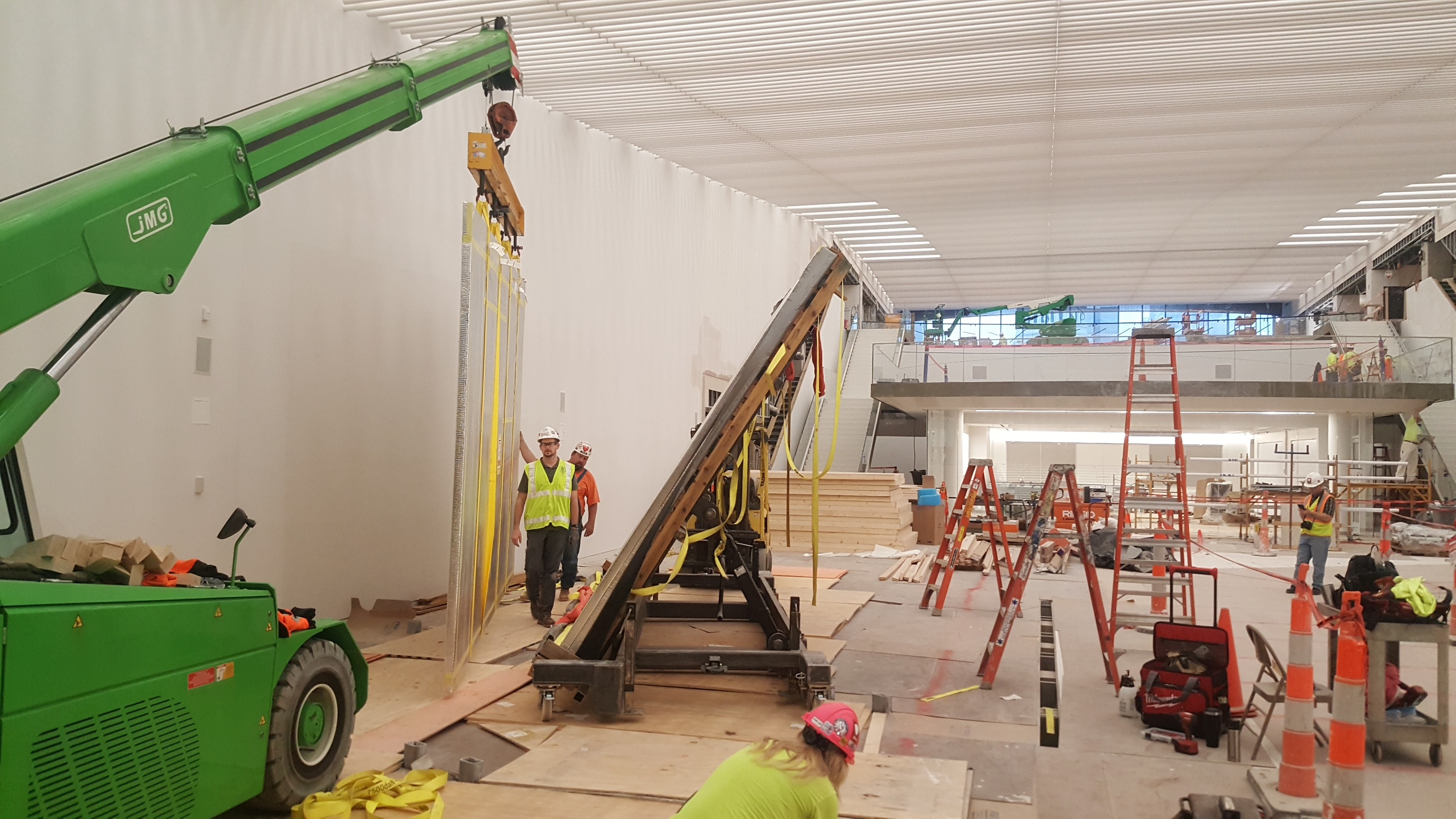 CSC uses an electric mini crane to hoist the first screen into place.