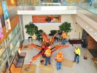 Jekko mini crane is unfolding to assist with a second story job.